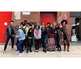 Group of teens posing for a picture in front of Studio Museum 127 with artists in residence