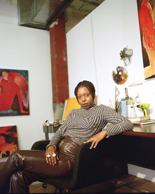 Portrait of artist in residence Naudline Pierre sitting in her studio